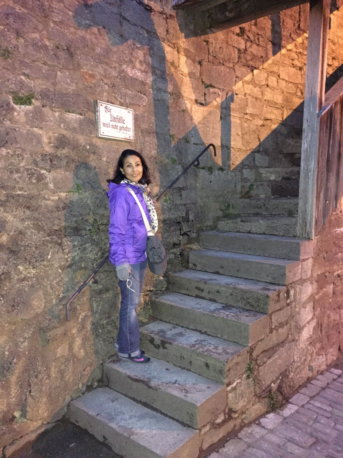 Veronica on the Stairwell to the medieval wall that surrounds Rothenberg