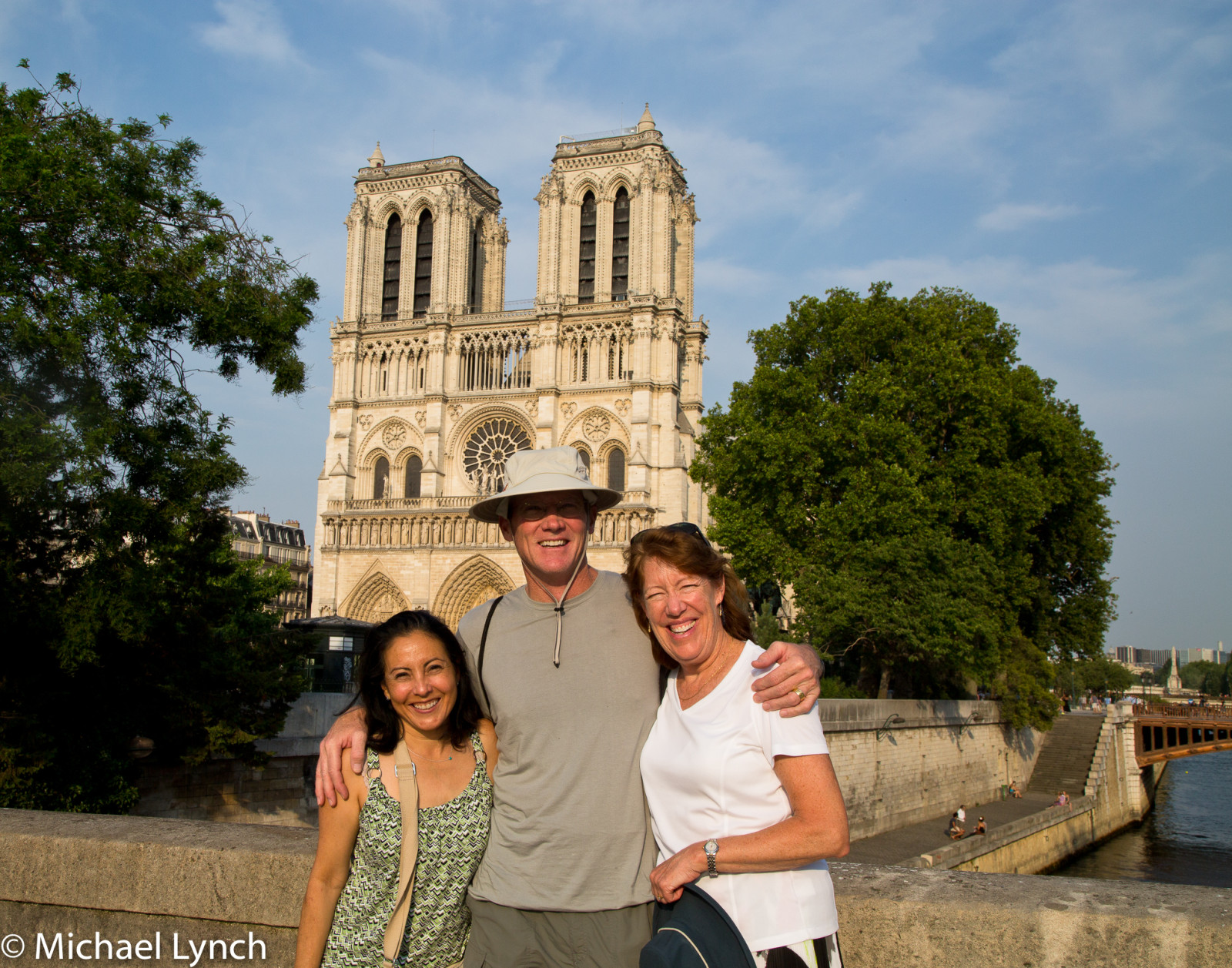 Veronica, Phil, and Sharon in front of Notre Dame